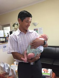 Dr. Zeng with clinic baby