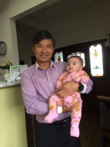 Acupuncturist Richard Zeng with baby